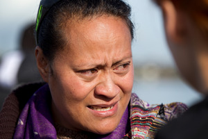 Latu Paasi mourns for her husband and son that are missing, as she is comforted by her family at the old Mangere Bridge this morning. Photo / Sarah Ivey