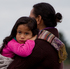 Latu Paasi (right) mourns for her husband and son that are missing, as she is comforted by her family. Photo / Sarah Ivey