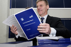 Finance Minister Bill English looking over copies of his 2012 Budget hot off the press in Parliament this morning. Photo / Mark Mitchell