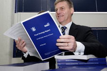 Finance Minister Bill English looking over copies of his 2012 Budget hot off the press at Printlink. Photo / Mark Mitchell