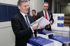 Finance Minister Bill English looking over copies of his 2012 Budget hot off the press at Printlink in, Wellington. Photo / Mark Mitchell