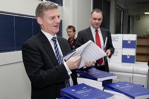 Bill English with copies of the 2012 Budget. Photo / Mark Mitchell