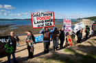 Protestors marched along the waterfront in Paihia and over the bridge to Waitangi. Photo / Sarah Ivey