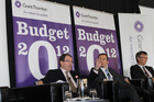 MPs John Banks (left) and David Parker flank economist Dominick Stephens at the post-Budget lunch yesterday at the Maritime Museum. Photo / Supplied