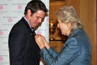 Princess Alexandra, the Queen's cousin, presents Gavin Bonner with the Royal Humane Society medal at the ceremony in London. Photo / Supplied