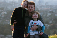 Martin Cocker says his phone has sometimes taken precedence to his boys Oliver (left) and Oscar. Photo / Supplied