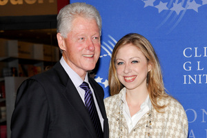 Bill Clinton and daughter Chelsea. Photo / AP