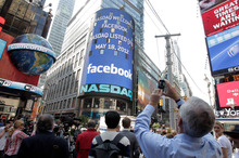 Nasdaq's giant monitor in Times Square shows a welcome message for Facebook. Photo / AP