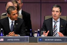 President Barack Obama stands looks to NATO Secretary General Anders Fogh Rasmussen. Photo / AP
