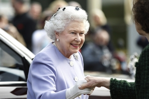 The Queen stays cool, keeping her clothes pressed. Photo / AP