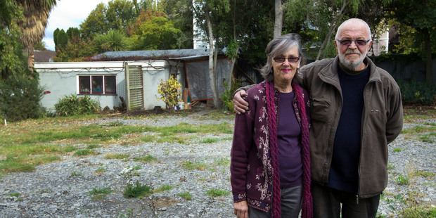 Bill and Kathy Lawrence on their empty section in central Christchurch. Photo / Simon Baker