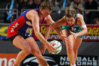 Chelsey Tregear of the Vixens and Charlotte Kight of the Mystics compete for the ball during the round eight ANZ Championship match. Photo / Getty Images.
