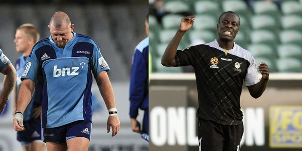Tony Woodcock of the Blues (left) and Malik Buari of the New Zealand Knights. Photo / Getty Images.