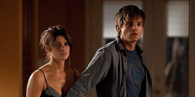 Ashley Greene and Sebastian Stan get scared in The Apparition.  Photo / Supplied