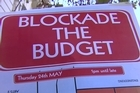 Students from Auckland Universities have blocked main streets in the central city in a protest called 'Blockade the Budget' as they oppose law changes concerning students and studies, released in the Government's 2012 Budget.