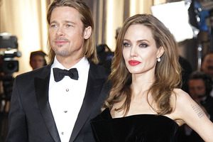 Brad Pitt says he won't be marrying Angelina Jolie in August.  Photo / AP