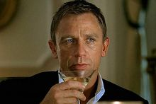 Daniel Craig's James Bond enjoys a martini. Photo / Supplied