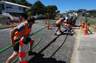 Contractors laying out fibre optic cable. The Commerce Commission says connection costs and availability of video content will be key factors in the uptake of ultra fast broadband. Photo / supplied