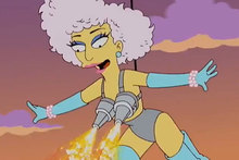 Lady Gaga's shows off her flaming bra during her cameo appearance on The Simpsons. Photo / YouTube