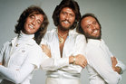 Barry Gibb, centre, has posted a touching tribute to his late brother Robin, left, online.  Photo / Supplied