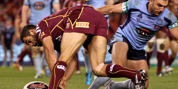 The ball is knocked out of Greg Inglis' hands during Origin I before he regathered to score. Photo / Getty Images