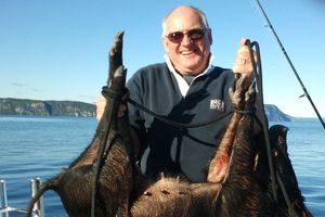 Bob Monteith hauled in a pig swimming from a dog on Lake Taupo.