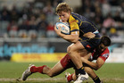 Michael Hooper of the Brumbies is tackled by Michael Harris of the Reds. Photo / Getty Images