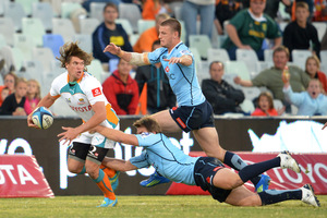 Riaan Smit of the Cheetahs tries to avoid the Waratahs' defenders. Photo / Getty Images