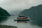 A runabout ferries passengers from the Milford Wanderer around the isolated inlets of Dusky Sound. Photo / Jim Eagles