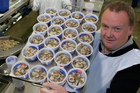 Graeme Wright, manager of Barnes Oysters in Invercargill, with a tray of oysters destined for the shops. Photo / Simon Baker