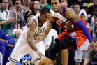 Boston Celtics guard Rajon Rondo drives against Philadelphia 76ers forward Andre Iguodala, right, during the fourth quarter of Game 7. Photo / AP