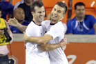 Ian Hogg (left) celebrates his goal on debut with Kosta Barbarouses in the All Whites match against El Salvador. Photo / AP