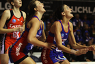 Anna Harrison of the Mystics is lifted up to defend a shot at goal by Jessica Moulds during the round nine ANZ Championship match. Photo / Getty Images.