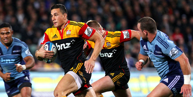Chiefs' Sonny Bill Williams makes a break during the Super Rugby match between the Blues and Chiefs at North Harbour Stadium. Photo / Anthony Au-Yeung.