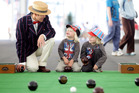 John Bembo tells Dylan and Woody Percival-Carter about bowls at the Cloud.  Photo / Janna Dixon