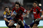 Crusaders' winger Zac Guildford on the way to scoring one of his two tries last night. Photo / Getty Images.