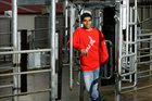 Engineering student Dushyant Parmar with the electronic gate at Kiwitahi farm. Photo / Stephen Barker