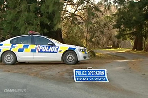 Police have set up a wide cordon around the homicide scene.  Photo / One News