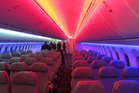 The disco-style, coloured lighting on board the new Boeing 787 Dreamliner. Photo / Grant Bradley