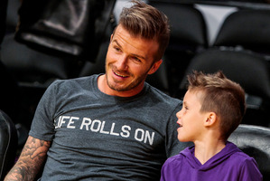 David Beckham with his son, Cruz. Photo / AP