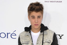 Justin Bieber suffered a concussion after walking into a glass wall, backstage of his Paris concert. Photo / AP