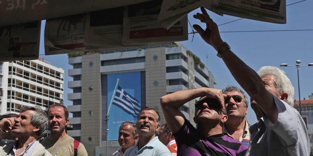 The tragedy unfolding in Greece is a sharp reminder of the crisis that can engulf a highly indebted country.  Photo / AP