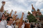 Opposition supporters wearing white ribbons as a symbol of the protest movement against Russian President Vladimir Putin rally at Red Square in front of the St. Basil's Cathedral in Moscow, Russia. Photo / AP