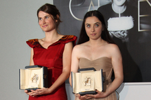 Actresses Cristina Flutur, left, and Cosmina Stratan pose with their awards. Photo / AP