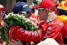 Dario Franchitti, left, of Scotland, is congratulated by Scott Dixon, of New Zealand. Photo / AP
