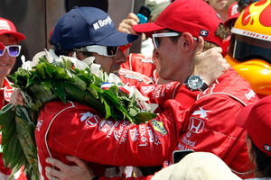 Dario Franchitti, left, of Scotland, is congratulated by Scott Dixon, of New Zealand. Photo / AP