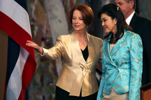 Thailand's Prime Minister Yingluck Shinawatra, right, is greeted by Australia's Prime Minister Julia Gillard. Photo / AP