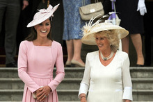 The Duchess of Cambridge (left) in her Kiwi-designed dress, and the Duchess of Cornwall. Photo / AP