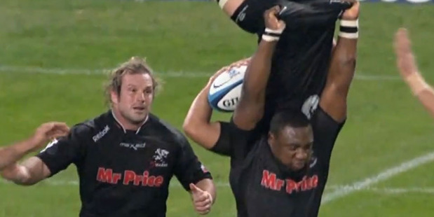 "Tendai ""The Beast"" Mtawarira lifts Anton Bresler high in the air. Photo / Youtube."