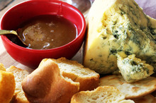 Strong-flavoured blue cheese goes well with honey. Photo / Doug Sherring